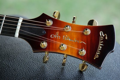 Headstock with thin maple binding and heavy Gotoh tuners